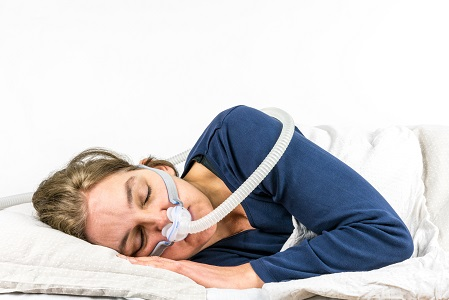 sleep apnea treatment with CPAP therapy woman, sleeping